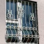 Стальные решетки на окна фото