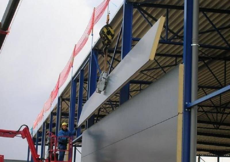 Процесс сборки зданий из панелей